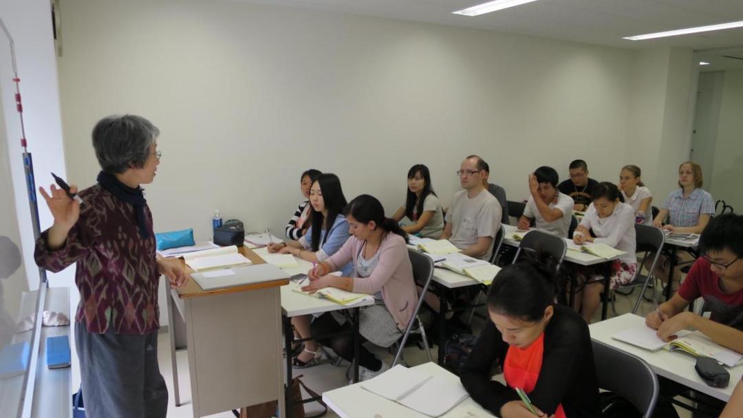 SAMY Language School classroom with teacher at whiteboard