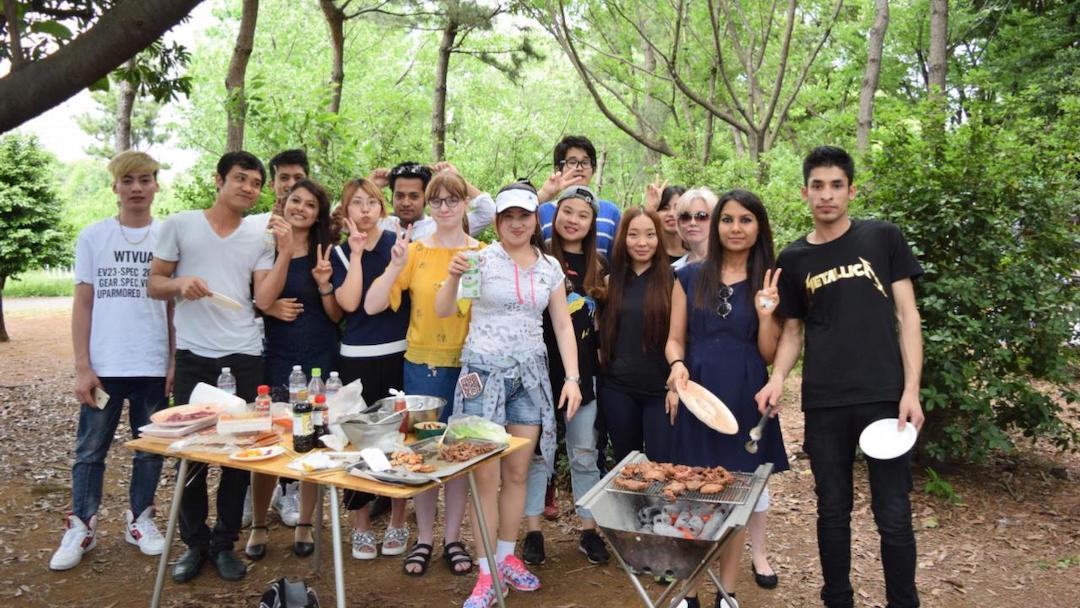 SAMU students outside at school BBQ event
