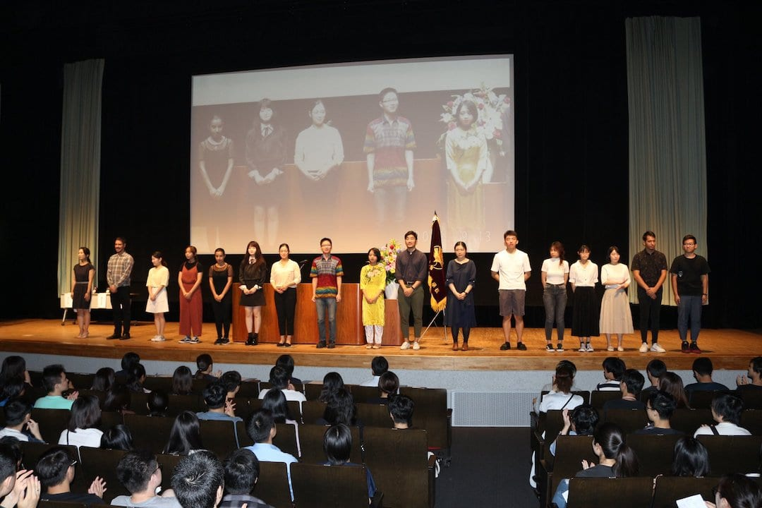 Akamonkai students presenting on a stage at a ceremony