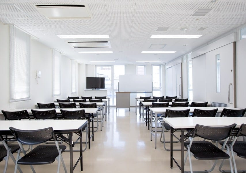 Japanese classroom with tables and chairs
