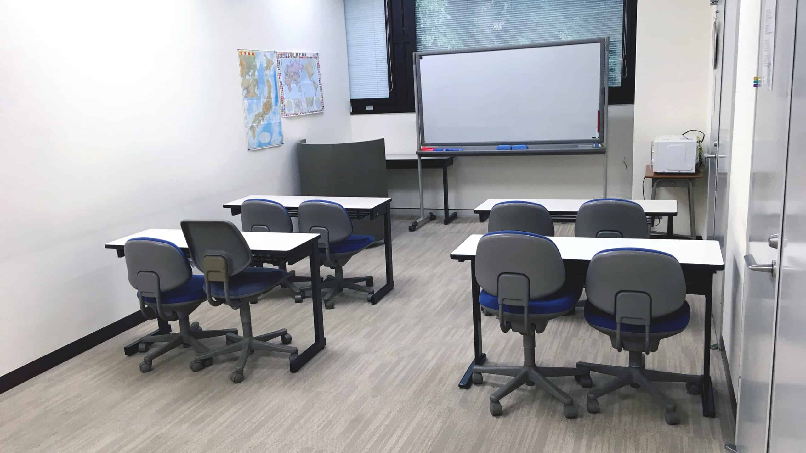 Japanese classroom with desks and a whiteboard